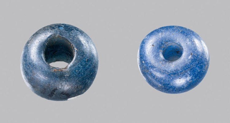 two cobalt-blue glass beads, found in 3,400-year-old graves in Denmark, came from ancient Egypt