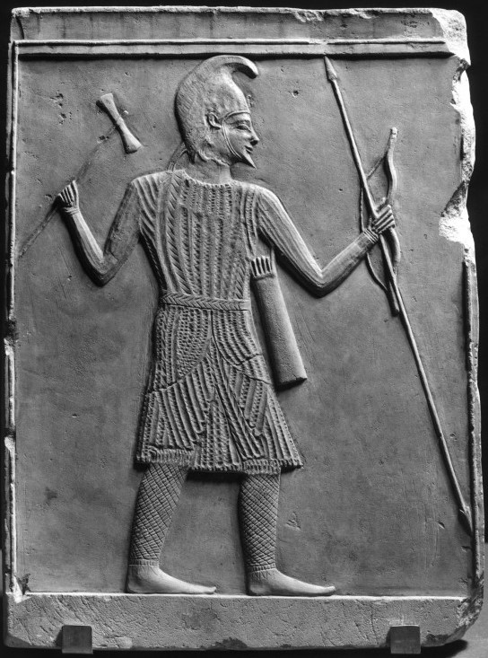 Greek relief depicts a Scythian warrior with an axe, bow, and spear -Walters Art Museum