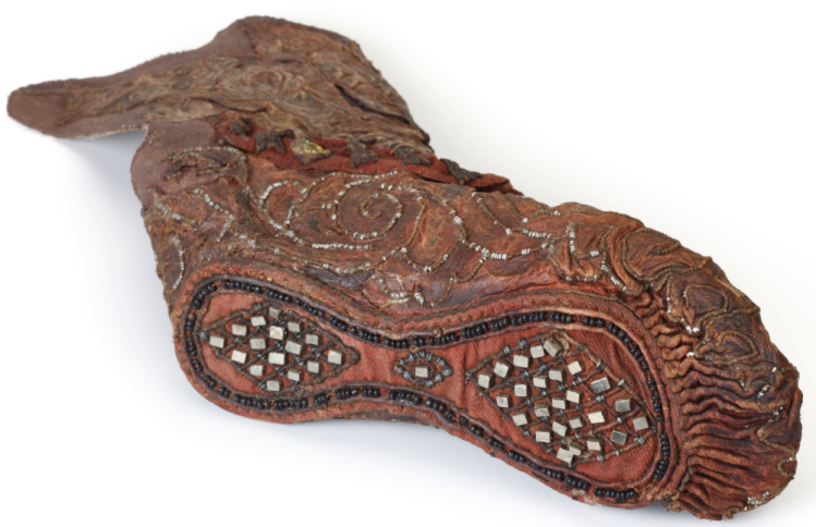 Woman's shoe. Leather, textile, tin, pyrite crystals, gold foil, glass beads. Pazyryk, Altai
